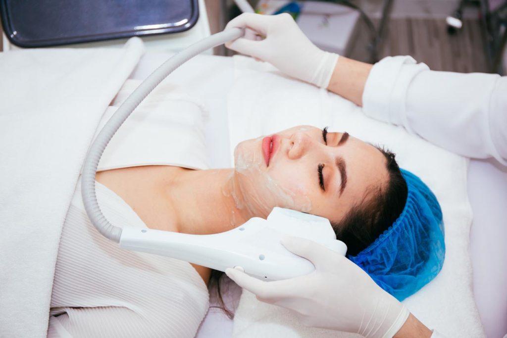 Young Asian woman getting ipl treatmen