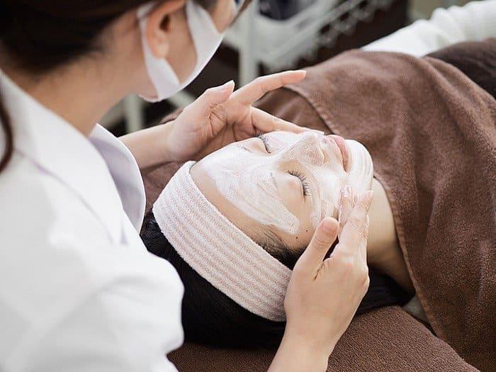 Lady having facial treatment