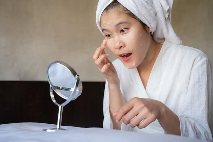 Lady apply skincare
